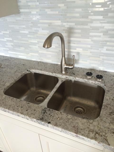 Kelowna and West Kelowna Plumbers - kitchen sink installed