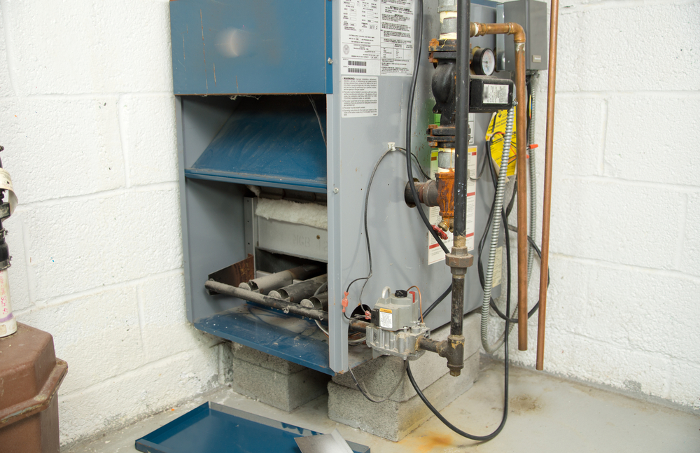 Kelowna Heating - A1 Choice - Furnace needing service in a home